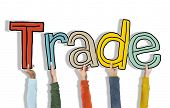 Group of Hands Holding Letter Trade