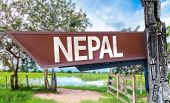 Nepal wooden sign with rural background