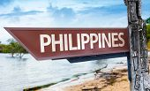 Philippines wooden sign with a lake background