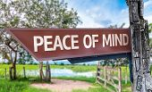 Peace of Mind wooden sign with rural background