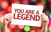 You are a Legend card with colorful background with defocused lights