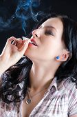 Woman Smoking A Cannabis Joint