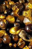 stock photo of tiger eye  - Tiger Eye Stones Ready to Make Handmade Jewelry - JPG