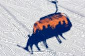 Abstract chairlift's shadow on snow