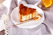 Cheese cake in plate on lace napkin