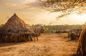 foto of ethiopia  - Africa Ethiopia huts in a Hamer village in the sunset light - JPG