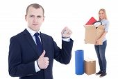 Moving Day Concept - Business Man With Metal Key And Girl With Box Isolated On White