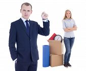 Moving Day Concept - Handsome Business Man With Key And Young Woman With Cardboard Boxes Isolated On