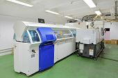 stock photo of manufacturing  - DVD and compact disc manufacturing machine in factory