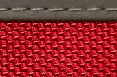 red fabric texture background with stitches