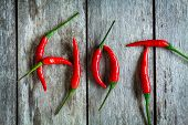 Red Hot Chili Peppers On A Wooden Rustic Background