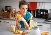 Happy Fitness Young Woman With Pumpkin Smoothie In Modern Kitchen