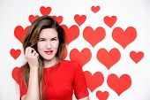 White caucasian woman with red lips standing on a heart shaped background.Valentine`s day