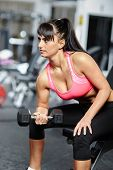 Girl Doing Biceps Workout In A Gym