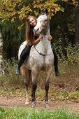 Beautiful Girl Riding A Horse Without Bridle Or Saddle
