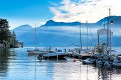 foto of dock a lake  - Dock boats at  the Lake of Como Italy - JPG