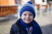 Little Boy In Winter Cap