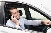Happy businessman on the phone in his car