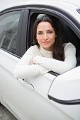 Young woman looking at camera in her car