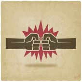punch fists fight symbol old background