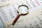 Magnifier Lying On The Calendar