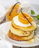 Pancakes with yoghurt and apricots