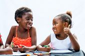 African Girl Showing Thumbs Up To Friend At Desk.