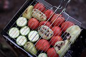 Sliced Tomatoes And Zucchini On Barbecue Grill