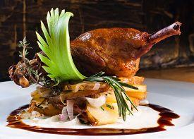 stock photo of canard  - Duck pestle with potato and garlic - JPG