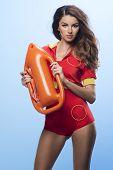 picture of lifeguard  - Beauty sexy lifeguard woman posing in studio - JPG