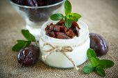 foto of prunes  - sweet milk yogurt with prunes in a glass jar - JPG