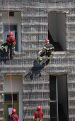 stock photo of firehouse  - four firefighters during rescue drills in the Firehouse - JPG