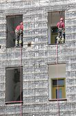 stock photo of firehouse  - two firefighters during rescue drills in the Firehouse - JPG