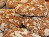 stock photo of whole-wheat  - genuine whole wheat bread baked in a wood - JPG