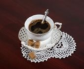 picture of doilies  - cup of coffee and a white lace doily on the table - JPG