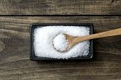 picture of salt-bowl  - sea salt in bowl and spoon on wooden table - JPG