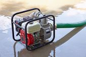 stock photo of flood  - Pumping water from a flooded area - JPG