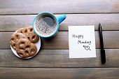 image of monday  - Cup of coffee with fresh cookies and Happy Monday massage on wooden background - JPG