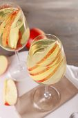 stock photo of cider apples  - Glasses of apple cider with fruits on table close up - JPG