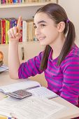 foto of schoolgirls  - Schoolgirl thinking at a solution and doing homework - JPG