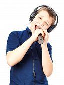 pic of singing  - Teenage boy in headphones - JPG