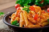 stock photo of chicken  - Penne pasta in tomato sauce with chicken - JPG