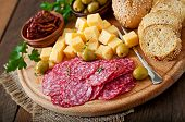 picture of antipasto  - Antipasto catering platter with salami and cheese on a wooden background - JPG