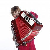 image of accordion  - very young girl with accordion in studio against white background - JPG