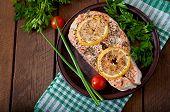 stock photo of salmon steak  - Baked salmon steak with lemon and herbs - JPG