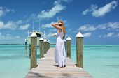 pic of jetties  - Girl on the wooden jetty looking to the ocean - JPG