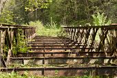 picture of old bridge  - Old rusty abandoned steel bridge over the river  - JPG