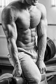 pic of abdominal muscle  - A man pumping abdominal muscles in the gym - JPG