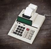 stock photo of budget  - Old calculator showing a text on display  - JPG