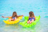 pic of mattress  - Adorable girl on air inflatable mattress in the sea - JPG